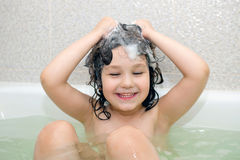 Happy small child bathing in bathtub Royalty Free Stock Photos