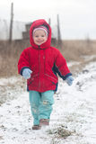 Happy small child go on the snow Royalty Free Stock Image