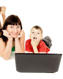 Happy a small child with her mother watch the movie the notebook Royalty Free Stock Photo