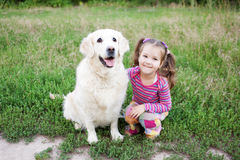 Happy small child hugging a dog Stock Photography