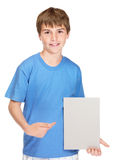 Happy small child pointing at an empty white board Stock Images