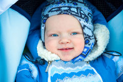 Happy small child in the winter Stock Images
