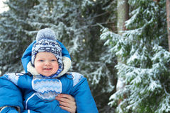 Happy small child in the winter Royalty Free Stock Image