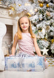 Happy small girl with christmas present Stock Images