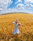 Happy small girl dancing in a field Royalty Free Stock Images