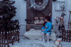 Happy small girl in dress with present have a christmas. Stock Image