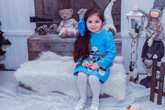 Happy small girl in dress with present have a christmas. Royalty Free Stock Photo