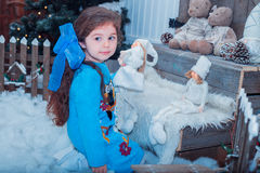 Happy small girl in dress with present have a christmas. Royalty Free Stock Photography