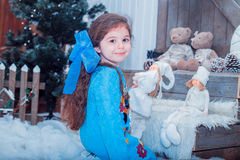 Happy small girl in dress with present have a christmas. Stock Photo