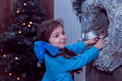 Happy small girl in dress with present have a christmas. Stock Images
