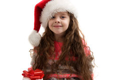 Happy small girl holding a box with a gift. Merry Christmas. Stock Photo