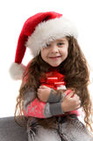 Happy small girl holding a box with a gift. Merry Christmas. Stock Photography