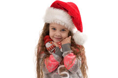 Happy small girl holding a Christmas toy. Stock Image