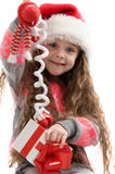 Happy small girl holding a Christmas toy. Stock Photography
