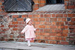 Happy small girl moving forward Royalty Free Stock Photography