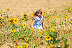 Happy small girl running in a field Royalty Free Stock Photography