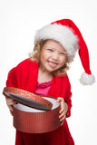 Happy small girl in Santa hat have a Christmas Stock Photos