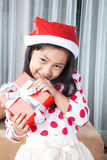 Happy small girl in Santa hat have a Christmas Royalty Free Stock Image