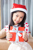 Happy small girl in Santa hat have a Christmas Stock Photography