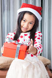 Happy small girl in Santa hat have a Christmas Stock Image