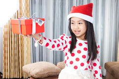 Happy small girl in Santa hat have a Christmas Royalty Free Stock Photography