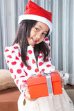 Happy small girl in Santa hat have a Christmas Royalty Free Stock Photo