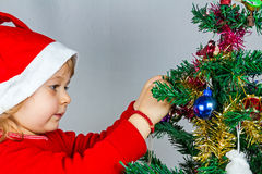 Happy small girl in Santa hat Royalty Free Stock Images