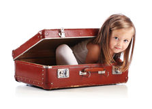 Happy small girl sitting in a suitcase. Travel Royalty Free Stock Photos