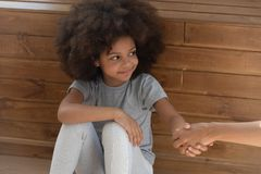 Free Happy Small Kid Girl Orphan Holding Hand Of Foster Parent Stock Photo - 149841510