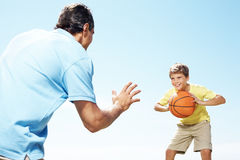 Happy small kid playing basketball with his father Royalty Free Stock Photography