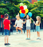 Happy small kids playing with jumping rope Stock Photo