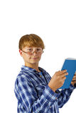 Happy smart boy is reading Stock Images