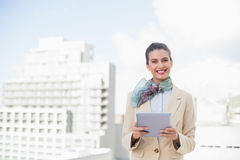 Happy smart brown haired businesswoman using a tablet pc Stock Image