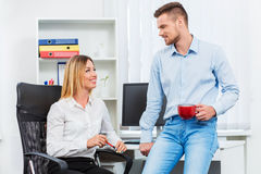 Happy smart business couple discussing Stock Photos