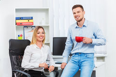 Happy smart business couple discussing Royalty Free Stock Image