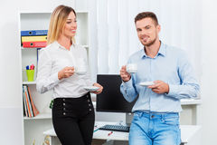 Happy smart business couple discussing Stock Photography