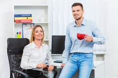 Happy smart business couple discussing Royalty Free Stock Photos