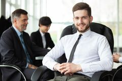 Happy smart business man with team mates discussing in the background royalty free stock photos