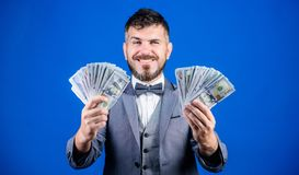 Happy with smart investments. Currency broker with bundle of money. Making money with his business. Business startup. Loan. Bearded man holding cash money. Rich royalty free stock photos