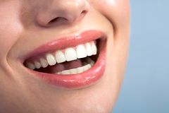 Happy smile. Close-up of happy female healthy teeth shown in smile royalty free stock photography