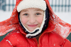 Happy smile. Portrait of a boy outside in a snow day Royalty Free Stock Photo
