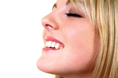 Happy Smile. Female smiling against white background Royalty Free Stock Photography