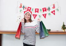 Happy smile Asia woman holding many shopping bag in party,buy Ch. Ristmas and new year present,Holiday season shopping,gift giving concept Royalty Free Stock Images