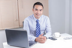 Happy smile asian business man sitting in office Royalty Free Stock Photo