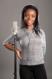 Happy smile by beautiful girl singer in studio Royalty Free Stock Images