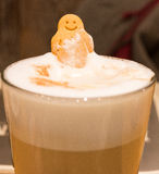 Happy cookie smile  emerging in the coffee Stock Image