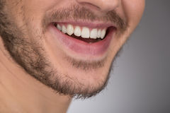 Happy smile. Cropped image of young men smiling while standing i Royalty Free Stock Photo