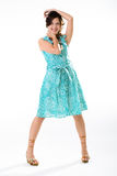 Happy smile cyan. Young multi-racial woman with a beautiful smile in a cyan dress Royalty Free Stock Photos