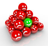 Happy Smile Face in Ball Pyramid of Sad Faces Stock Image