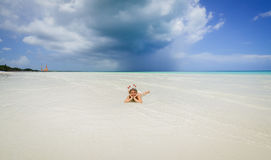 happy smile little girl lying in clear ocean water and relaxing on Cayo Coco island amazing beach Stock Photography